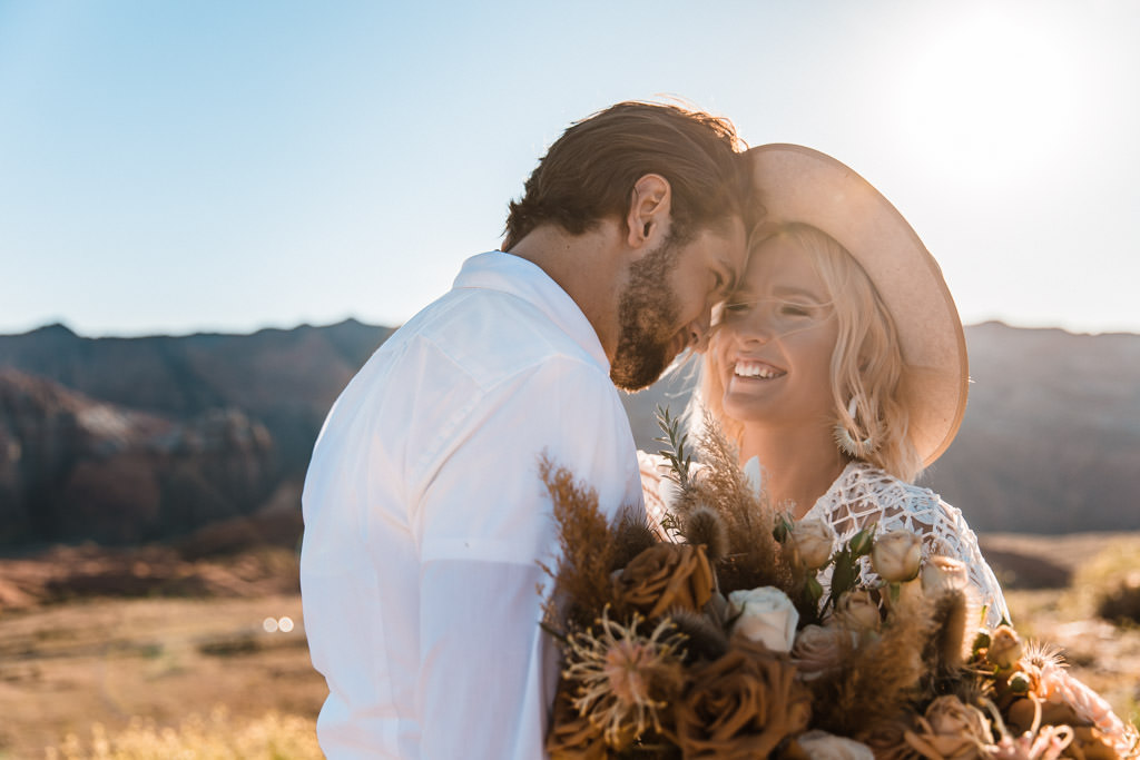 A bridal hat like the one pictured here is a new trend for boho elopements.