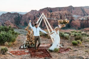 Newly married couple celebrates after their small boho elopement in Zion National Park.