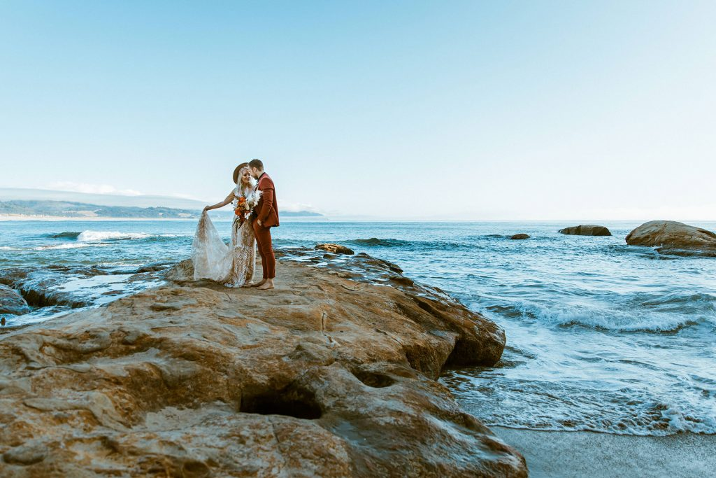 Small wedding on a California beach captured by elopement photographer Wind and Sky Photography.