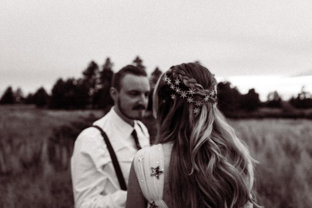 Gold star hair clips in a bridal braided hair do during a mountain celestial wedding.