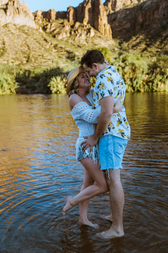 Engaged couple adventures into the Kern River for their summer engagement photo session.