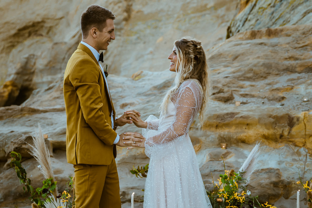 Couple say their wedding vows during a small elopement on a beach in Malibu.