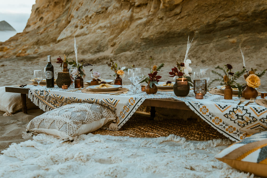 Styled reception picnic for a small wedding after a couple has an elopement on a beach in Malibu.