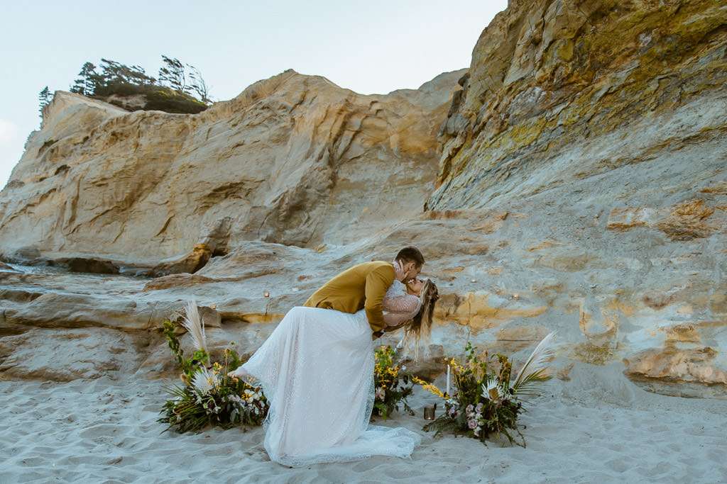 Couple kisses in the sand during their Malibu beach elopement.
