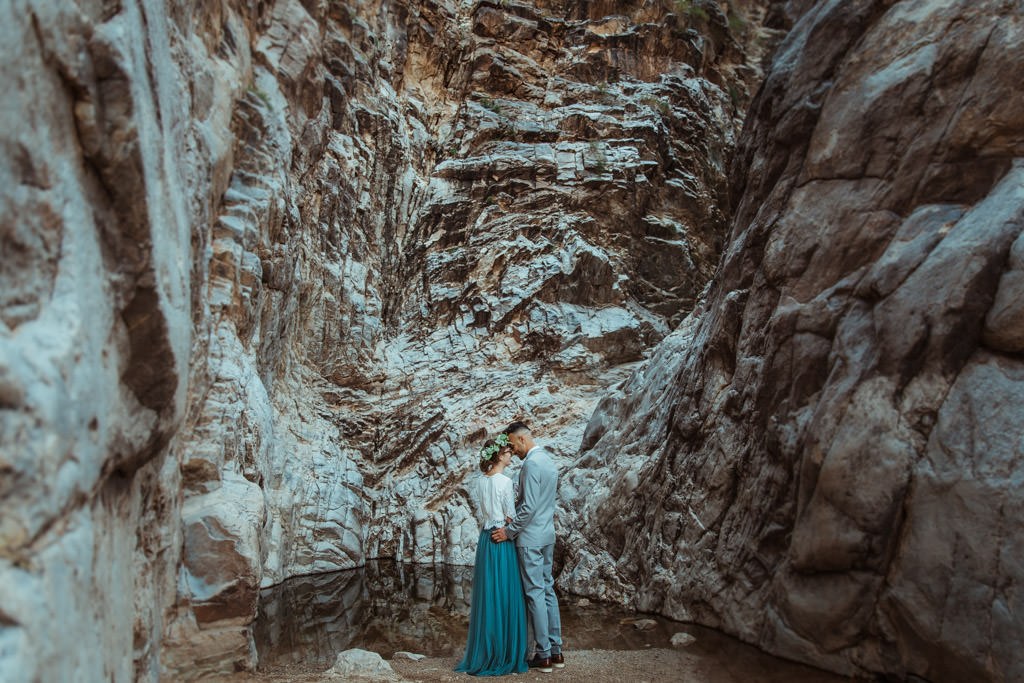Mountain elopement featuring spring flowers and a blue wedding dress.