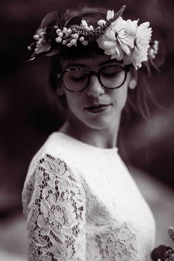 Bride wears a flower crown for her spring mountain elopement.
