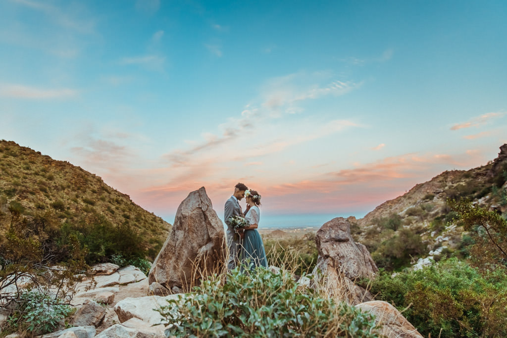 Bride and groom see a mountain sunset after their spring elopement.