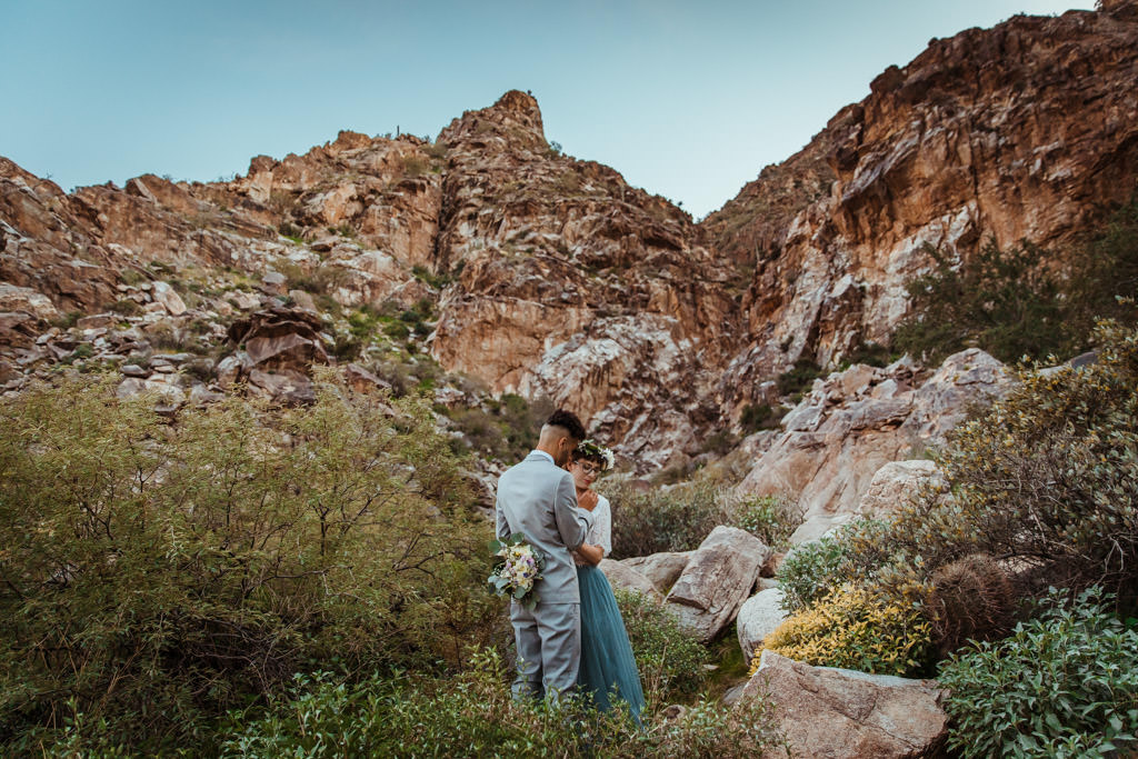 Bride and groom get married in a spring mountain elopement.