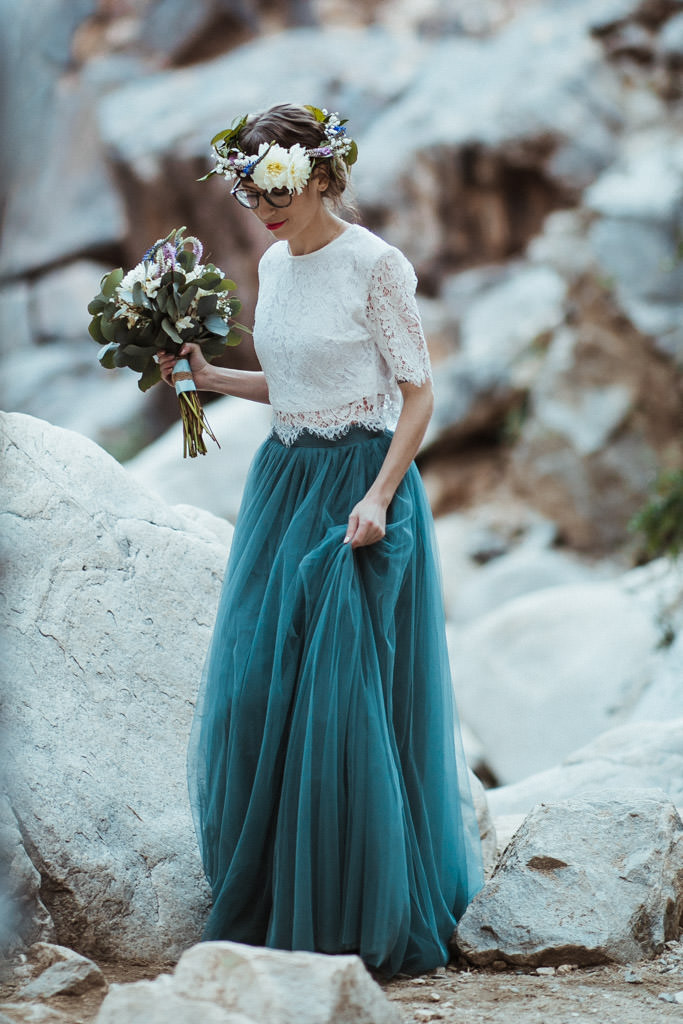 Bride wears a floral crown and blue wedding dress for her spring mountain elopement.