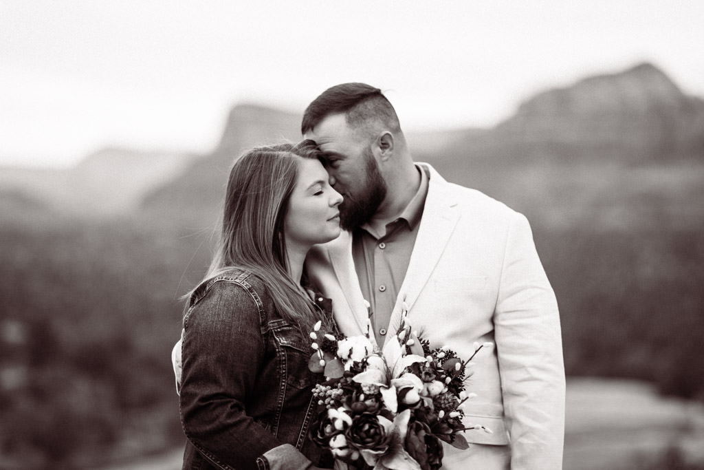 Black and white photo of couple kissing during their elopement in Sedona, Arizona.