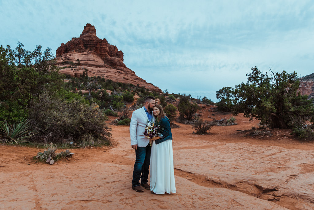 Couple poses in front of Bell Rock after their Sedona, Arizona elopement.